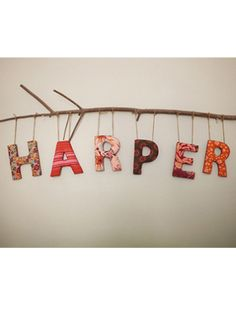 Hanging letters - love the branch idea with for her name with the love birds nursery theme :)