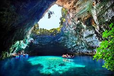 The Melissani Cave Lake, located near Kefalonia, Greece, was a hidden treasure up until the roof of the cave collapsed after an earthquake in 1953. The mystical sky-blue lake, surrounded by a thick forest, is its most charming in July and August when sunlight pervades the area, changing the color of the water and reflecting it on the surrounding walls.
