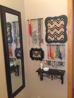 cute and creative way to store and display your jewelry in your bathroom – small shelf, short rods, and black wooden plaques. | Its for the Home