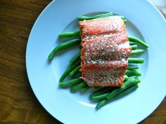 How To Cook Salmon Perfectly: sprinkle with salt and pepper and olive oil, Lay salmon on a lined baking sheet and place in a cold oven. Heat to 400 degrees and remove from oven after 25 minutes.