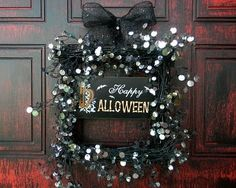 I'm not sure which I like more, the marvelous crimson and black door or the shimmery Halloween wreath. #Halloween #decor #decorations #fall #autumn #wreath #crafts