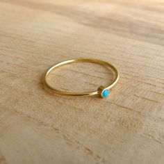 Having a hay day on this site!  Thin Gold Ring - Delicate Gold Rings - Gemstone Ring. $48.00, via Etsy.