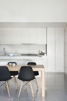 marble + white kitchen | eames chairs || Bower Architecture