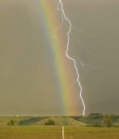 A lightning strike through a rainbow