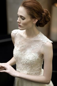 bun and beautiful lace wedding dress