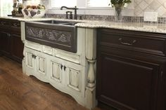 beautiful 'antique' kitchen.....love the old, white piece of furniture used as a cabinet (and that beautiful sink!).....