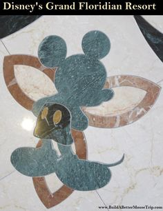 Mickey Mouse inlay in the marble floor in the lobby at Disney's Grand Floridian Resort.  For more resort photos, see: http://www.buildabettermousetrip.com/disneys-grand-floridian   #Mickey Mouse #GrandFloridian #Disneyworld #WDW