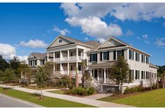 Wide and welcoming porches and graceful arches. Timeless Carolina style marks these new Rivergreen Place Townhomes from David Weekley Homes in Charleston, S.C.
