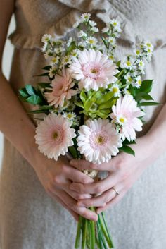 Pale pink gerber daisies with white monte casino and tropical foliage  Orlando wedding flowers | www.weddingsbycarlyanes.com