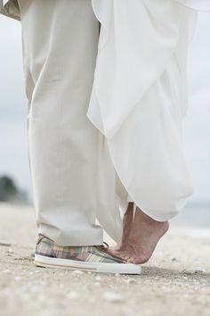 Adorable beach wedding photo. A photo of our feet, barefoot of course