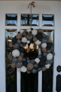 Front door with Yarn Ball Wreath