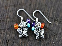 "Island Cowgirl silver jewelry pieces are a staple here at Quirks of Art! This pair of ""baby"" earrings feature Sweet butterflies that dangle with accent beads. Beads are Amethyst, Turquoise, and Carnelian. 1"" long. $46 at Quirks of Art. We think this pair is a great addition to a little girls collection.... as well as those young at heart!"