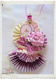 Handmade paper rosette by IngeborgvanZuiden, via Flickr
