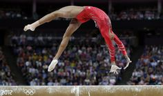 U.S. gymnast Gabrielle Douglas performs on the balance beam during the Artistic Gymnastics women's team final at the 2012 Summer Olympics, Tuesday, July 31, 2012, in London. (AP Photo/Julie Jacobson)