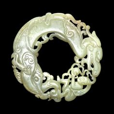 Archaistic jade ring /  pendant. Ming dynasty, 15th-16th century AD, China. In the shape of a dragon and a boy.
