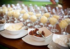 """Mashed Potato Bar...all the """"loaded"""" toppings you can imagine, and pretty serving bowls (like the tater-tinis, shown).  This would be a hit in any group!"""