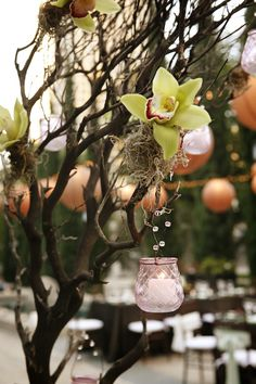 I'd love to do something like this for centerpieces, use twigs ribboned together and attach flowers like this