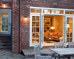converted garage into a family room with beautiful entrance to patio