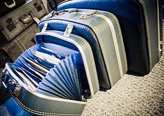 recycle your old suitcases into an accordian file folder!