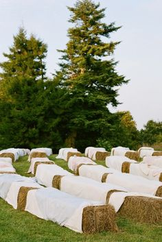 love the hay bales as seating for a country-chic wedding! Use muslin for cover
