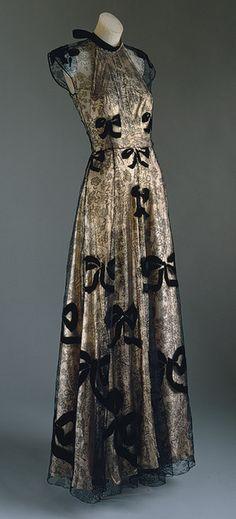 Evening gown, 1939 Madeleine Vionnet (French) Pale pink lamé and black silk lace appliquéd with black silk velvet