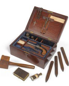"""Victorian vampire-slaying kit up for auction contains a 1851 prayer book & vampire-slaying equipment. The 19th Century box contains a crucifix, pistol, wooden stakes and mallet, holy water, holy earth & garlic. It was left to a Yorkshire woman in her uncle's will. Tennants Auctioneers in Leyburn, North Yorkshire will auction it. It holds a  handwritten quote from Luke 19:27.  """"But those mine enemies, which would not that I should reign over them, bring hither, and slay them before me."""""""