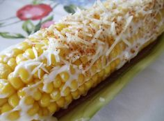 Crazy Corn roasted in foil on grill, spread on mayonnaise and Cajun seasoning.