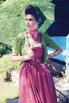 I dig the retro styling of this beautiful pink and green dirndl outfit. #dirndl #dress #folk #costume #German #clothing #umbrella #parasol
