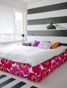 Covering a platform bed or boxspring with a bold pattern. Might do this to keep Halo out from under bed!!!