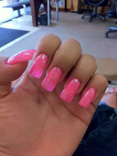 Long summer pink acrylics with a dash of glitter.