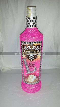 click picture for how to mod podge on some rhinestones and glitter to a alcohol bottle to make a cute 21st birthday gift DIY girly idea craft fun teen decorative design glitter sparkle pink monogram iced cake smirinoff