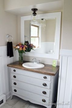 Pretty bathroom makeover with DIY dresser turned vanity. @Traci Puk Puk @ Beneath My Heart