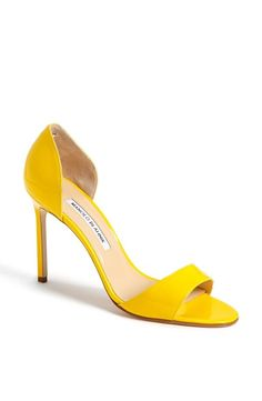 A bright yellow sandal for the bride.