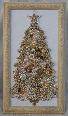 Framed Jewelry Christmas Tree  This is the coolest idea I've seen.  All those old earings that has broken and you don't want anymore but don't want to throw away!  Very cool idea!
