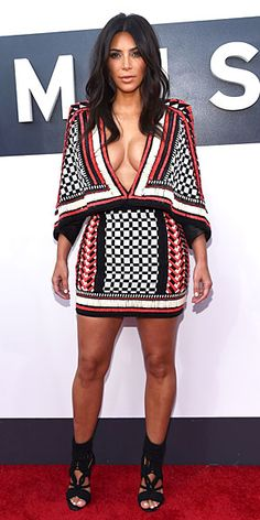 KIM KARDASHIAN That the reality star would find a unique way to show off her cleavage was a given. That she'd do it in an afghan she stole from her grandma's couch: less expected. She jazzes it up with lots of beading and sexy shoes.