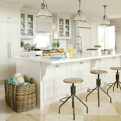 Custom cabinets with a traditional aesthetic add cottage style. Vintage bar stools stools and lighting add utility and an industrial, decorative edge. Coastalliving.com