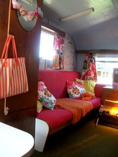 Love the use of maps on the walls and fun IKEA fabric in this bright and cheery camper
