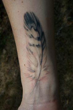 Delicate feather #tattoo, by Thea Duskin  #body_art...this looks like a real feather!