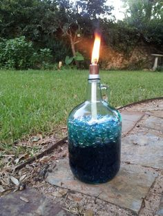 "DIY Tiki Torch  1. Empty Wine Bottle (You can use any bottle you like as long as it's glass and the neck is 1"" in diameter. Be clever!) 2. Teflon Tape 1/2"" 3. 1/2"" x 3/8"" Copper Coupling  4. 1/2"" Copper Cap 5. Tiki Replacement Wick  6. Torch Fuel (I used Citronella because I'm in Texas and mosquitos are the unofficial state birds)  7. Glass hobby beads/marbles (to fill up the extra empty space in the much larger bottles, helps to use less fuel and a way to add color)"