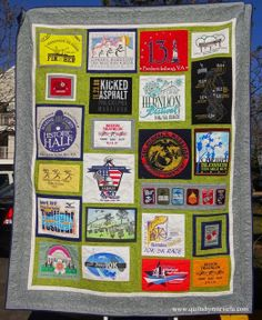 With lots of love to my friend Luz who I admire for being a great mom and athlete. This quilt is made of t-shirts from all her triathlon and marathon races.  Notice the design, it's not just t-shirts in a grid like you always see. Lots of detail work on it: each t-shirt was outlined with Free Motion. Flowers and loops as a filler in the green sashing and I love the final look of the leaves border - which by the way, I didn't mark at all!  www.quiltsbymarisela.com