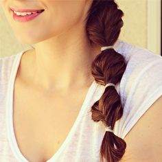 Try a twist on the fishtail braid: pull your hair into a side ponytail and secure with an elastic. Then, fishtail braid a section of hair, tie it off with an elastic and repeat!