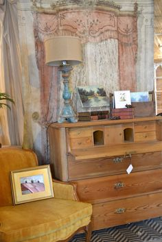 Antique pine desk w/ paper wall hanging backdrop.  Great office!