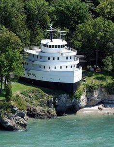 Cruise Ship House, Ohio. This is located on Lake Erie, Put-in Bay, South Bass Island. It originally was owned by Henry Ford and it was named after his Grandson, Benson Ford. Mr Frank J Sullivan purchased it and transformed it into his home. Awesome!