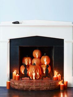 Flaming pumpkins! awesome fireplace decoration - or even better for a Sleepy Hollow look.