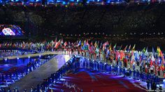 Flag bearers parade during the closing ceremony