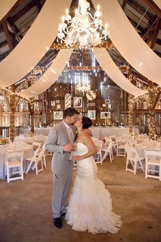 Love everything! The barn, the decor, the lighting and the dress.  rustic elegant wedding reception