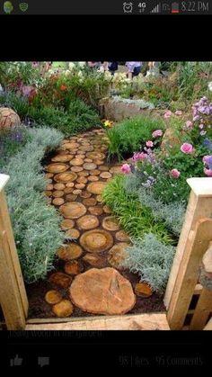 Secret garden ideas, love the tree trunk path.