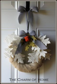 so cute! a fall wreath with book page leaves.