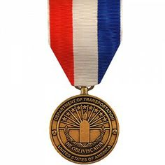 The Department of Transportation 9-11 Medal was created in 2002 to recognize the heroic deeds preformed by civilians and members of the U.S. Armed Forces during the immediate aftermath of the September 11th attacks on the United States. It is to recognize individual acts of heroism and bravery that resulted in the saving of life or exceptional assistance in the rescue efforts following the attacks.