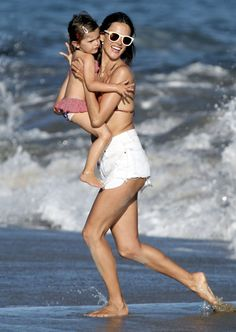 Alessandra Ambrosio frolics on the beach in Malibu, CA.